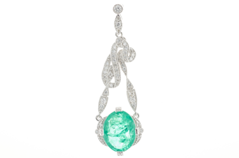 A PLATINUM EMERALD AND DIAMOND PENDANT