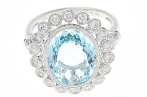AN AQUAMARINE AND DIAMOND CLUSTER COCKTAIL RING