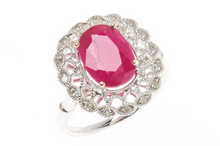 AN 18CT WHITE GOLD RUBY AND DIAMOND DRESS RING