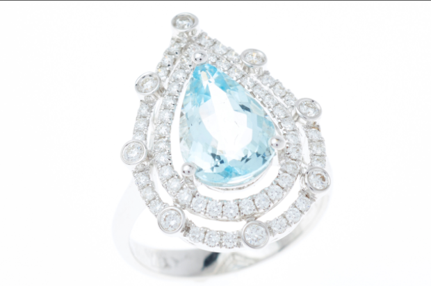 AN IMPRESSIVE AQUAMARINE AND DIAMOND COCKTAIL RING