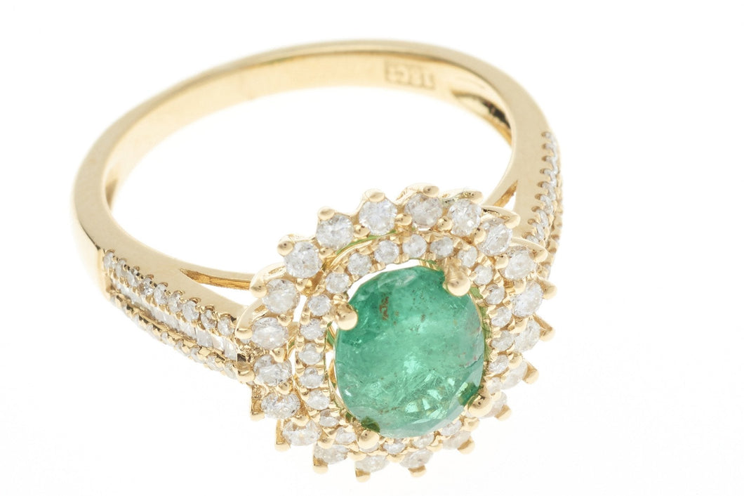 AN EMERALD AND DIAMOND STAR BURST CLUSTER RING