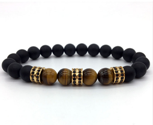 Bracelet made of hematite with zircons and tiger's eye.