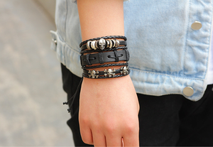 Set of 6 leather bracelets with skulls