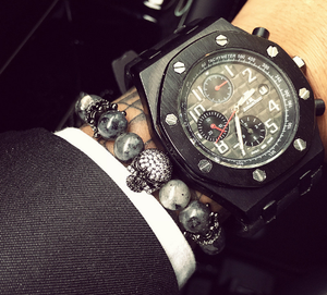 Gray bracelet of real stones with a skull and cz