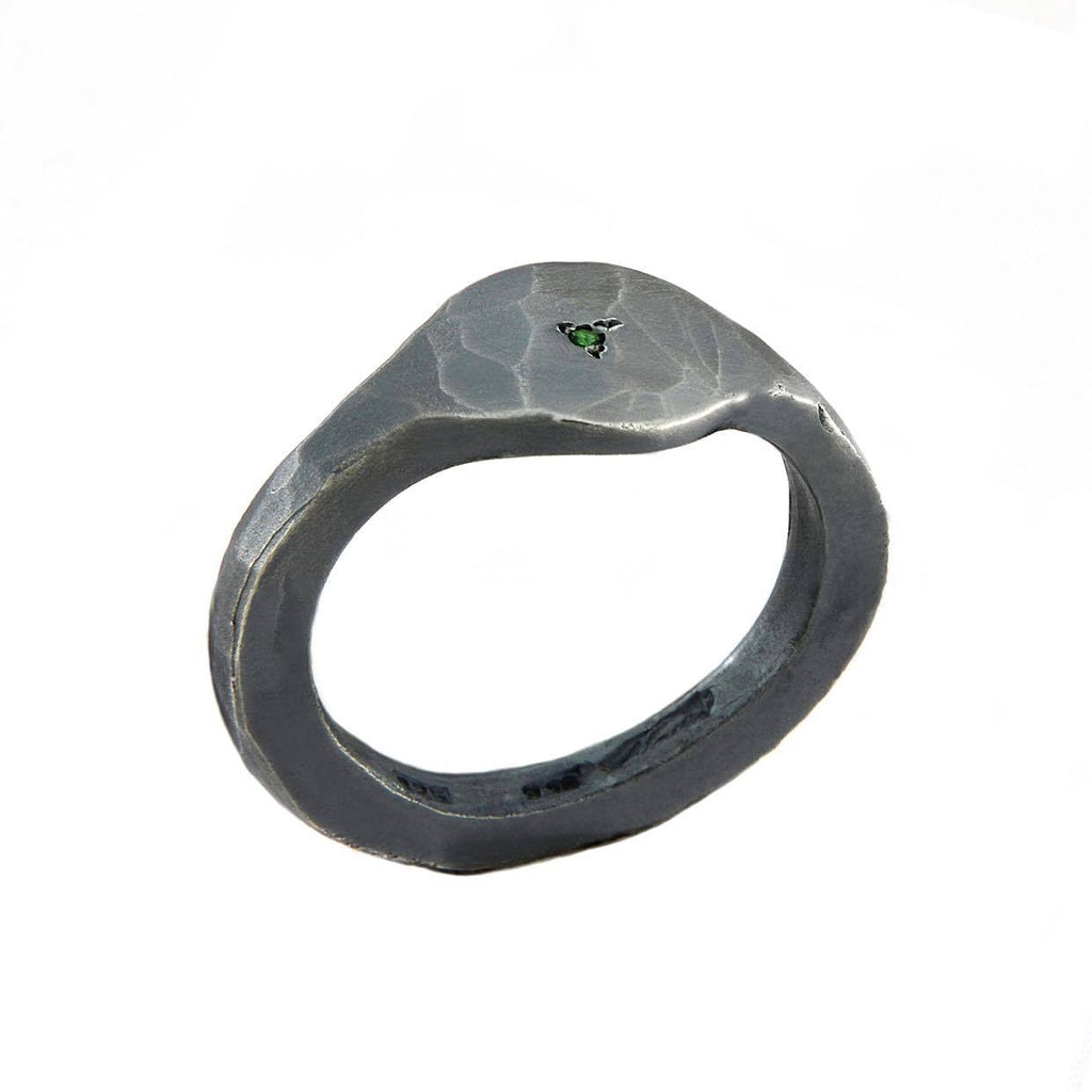 Carved ring with tsavorite