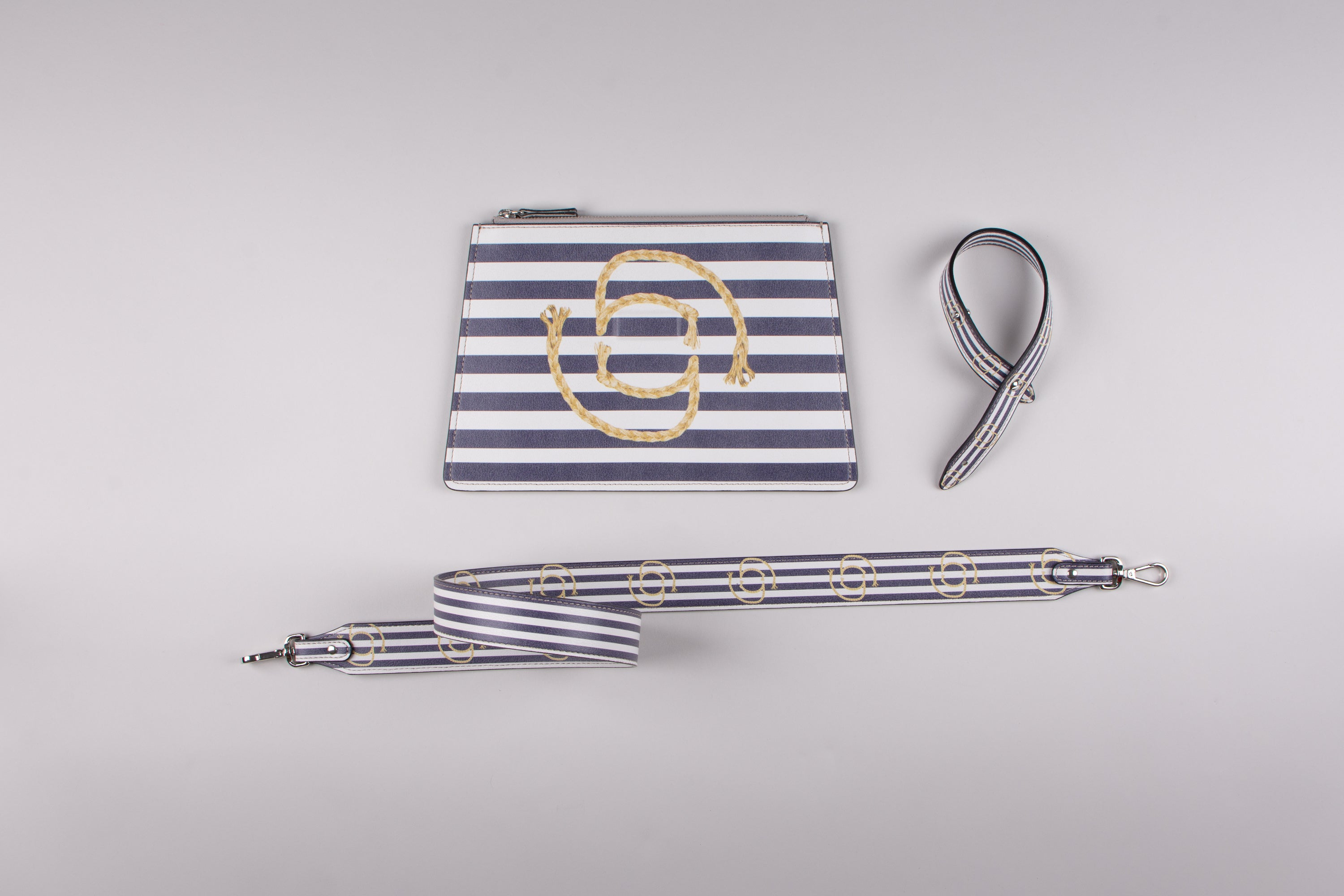 happy genie bag, happy genie, luxury bag, apple bag, apple skin, apple leather, vegan leather, multifunctional bag, clutch set, stripes, blue, marine, innovative material.