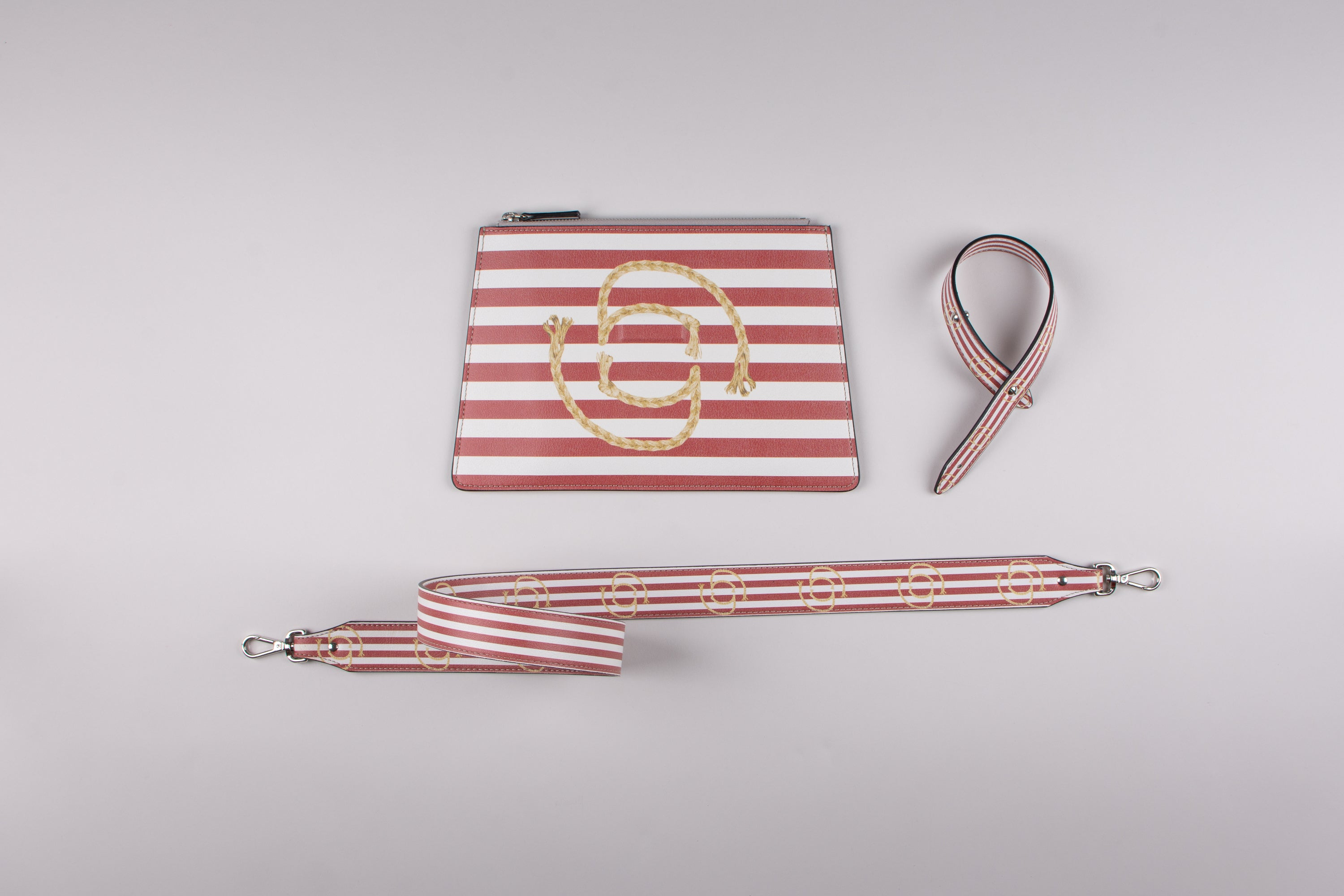 happy genie bag, happy genie, luxury bag, apple bag, apple skin, apple leather, vegan leather, multifunctional bag, clutch set, stripes, red, marine, innovative material.