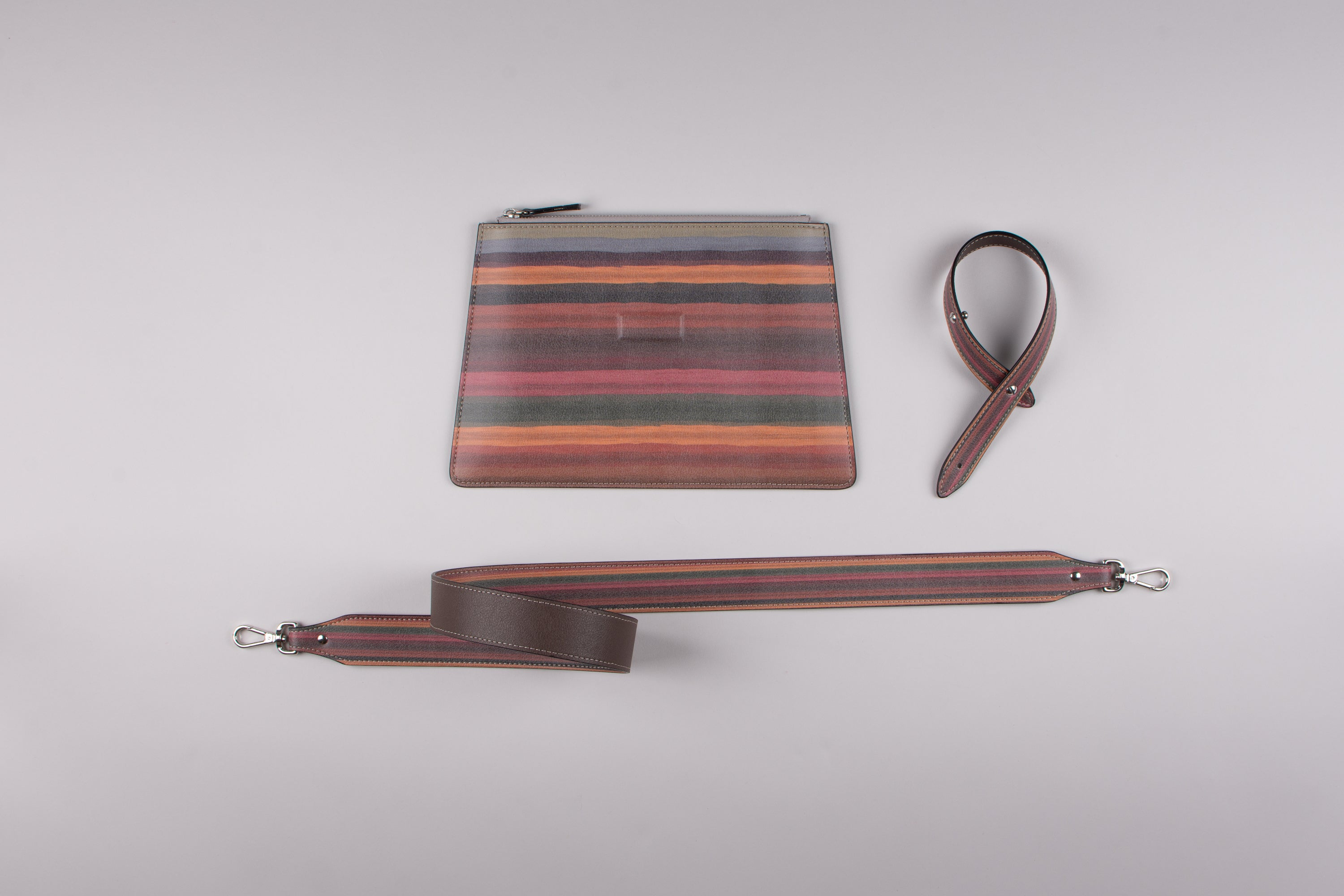 happy genie bag, happy genie, luxury bag, apple bag, apple skin, apple leather, vegan leather, multifunctional bag, clutch set, stripes, innovative material.
