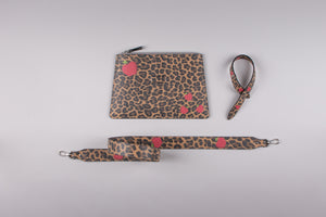 happy genie bag, happy genie, luxury bag, apple bag, apple skin, apple leather, vegan leather, multifunctional bag, clutch set, animal, leopard, innovative material.