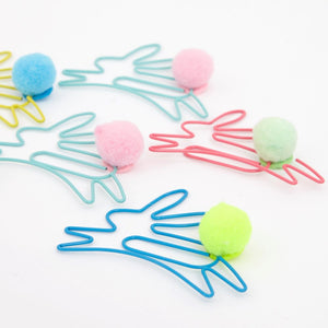 These bunny paper clips are crafted from coated wire and are embellished with fabulous little pompom tails.