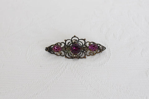 VINTAGE PURPLE RHINESTONE GOLD TONE BROOCH