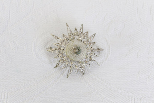 VINTAGE FILIGREE SILVER PLATED SUNBURST BROOCH