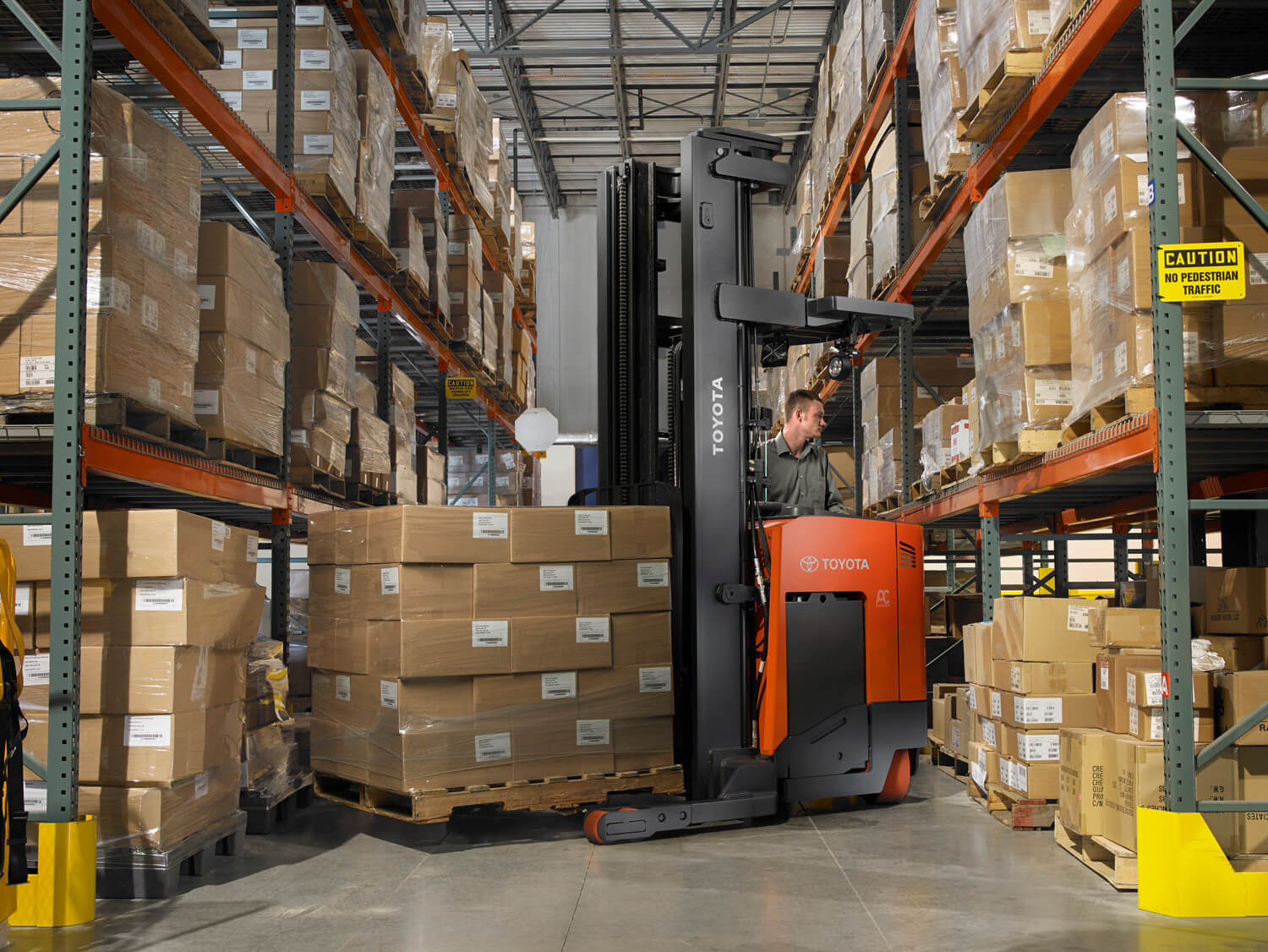 Toyota Electric Reach Truck Turning In Aisle