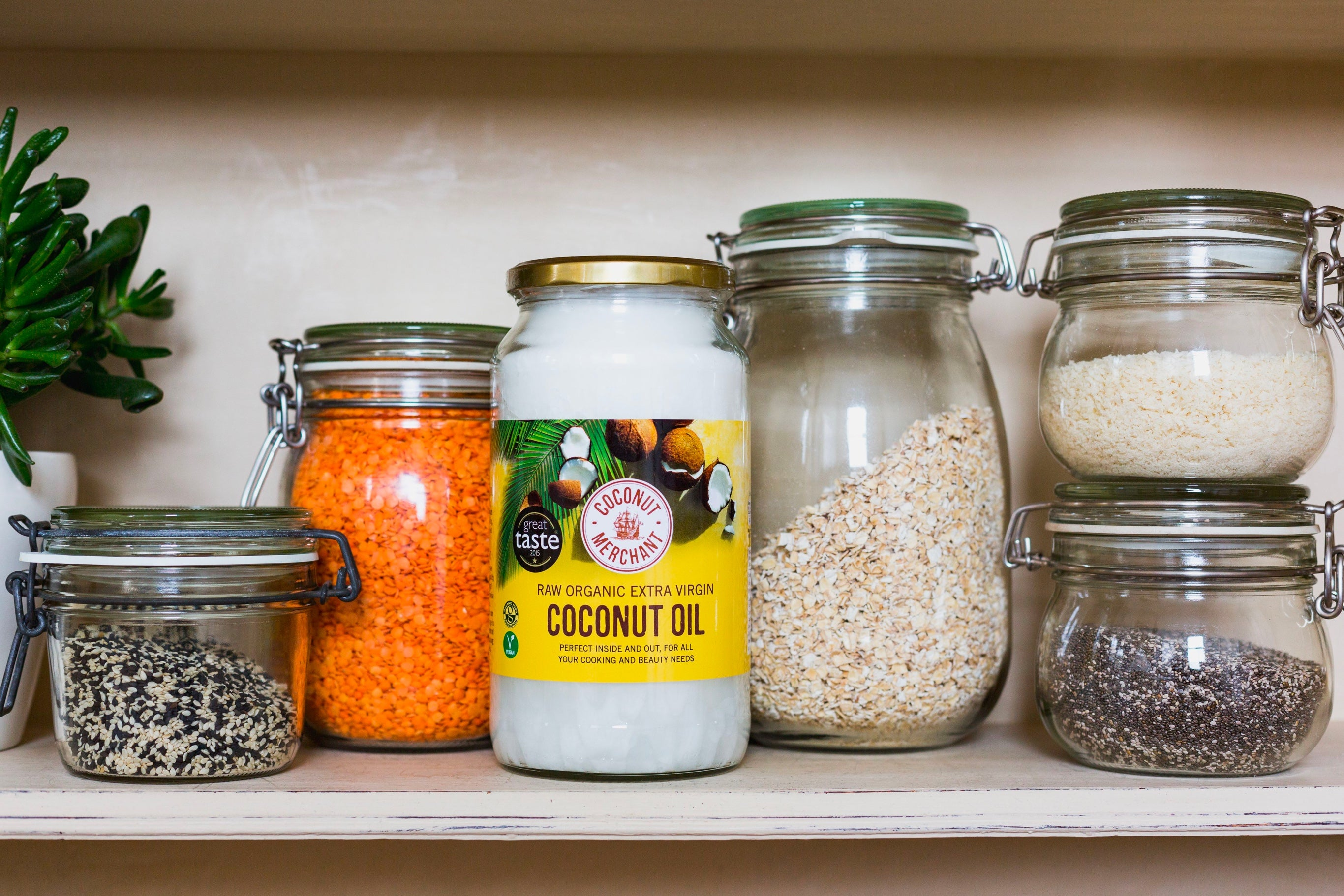 Shelf with ingredients on including a jar of coconut oil