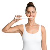 Female model using the Silk'n Toothwave Toothbrush