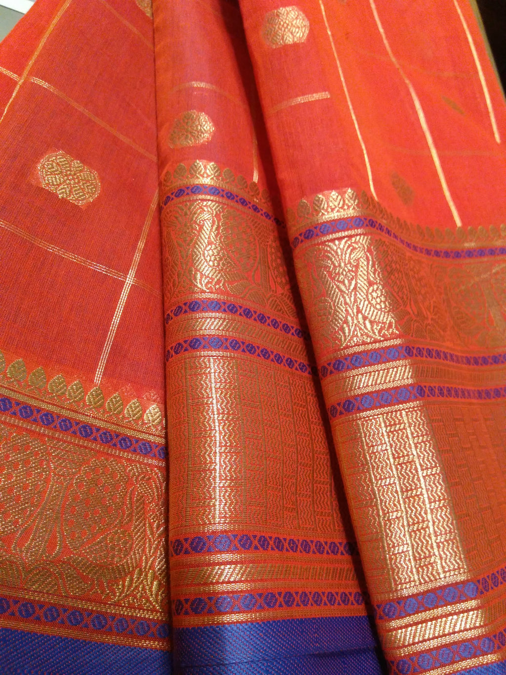Red chanderi saree with allover golden zari checks with butties