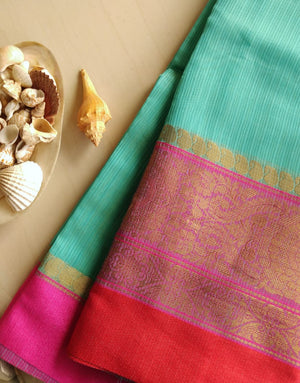 Sea green kota saree with wide intricate pink border