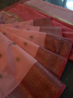 Light pink kota saree with golden zari weaving on red border and golden booties all over