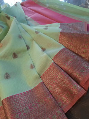 Light green kota saree with golden zari weaving on red border and golden booties all over