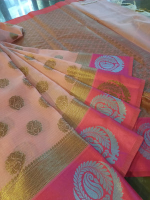 Light pink kota saree with golden and silver motifs on pink border and golden booties all over
