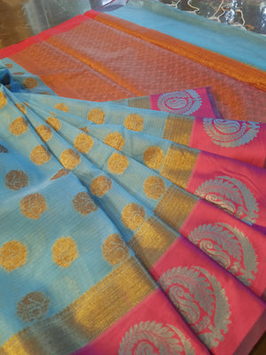 Blue kota saree with silver and golden motifs on pink border and golden booties all over