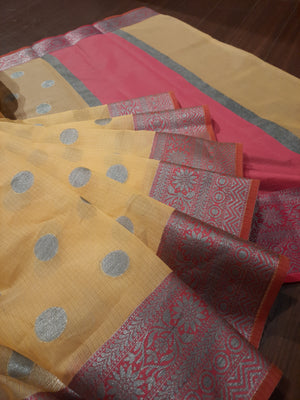 Yellow kota saree with silver zari weaving on pink border and silver booties all over
