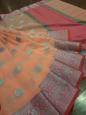 Light orange kota saree with silver zari weaving on pink border and silver booties all over