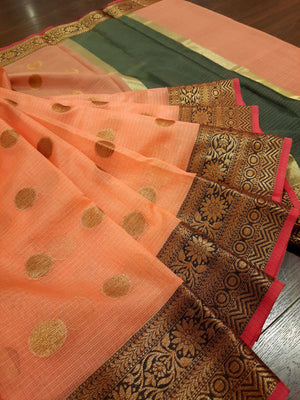 Orange kota saree with golden zari weaving and golden booties all over