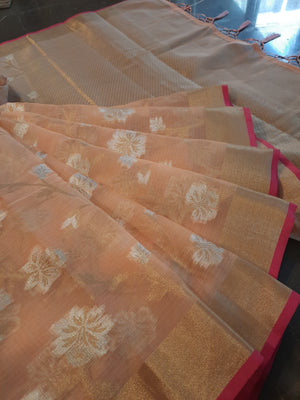 Light orange kota saree with golden zari weaving and golden with white flower Jaal over all