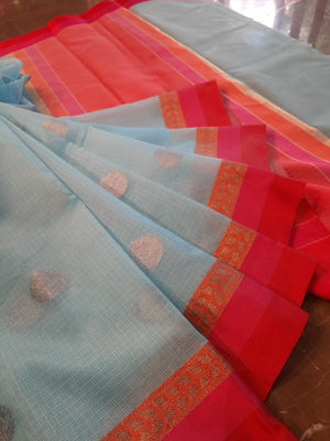 Sky blue kota saree with red border and silver booties all over