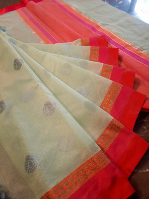 Light green kota saree with red border and silver booties all over