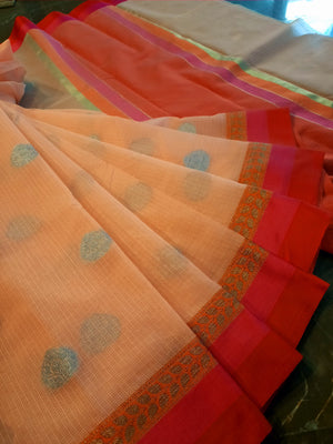 Light orange kota saree with red border and silver booties all over