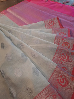 Light grey kota saree with silver zari weaving on pink border and silver booties all over