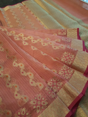 Light pink kota saree with golden motifs all over and golden zari weaving