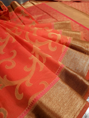 Orange kota saree with golden jaal overall and golden zari weaving