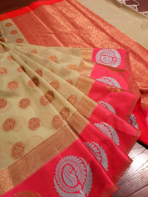 Light green kota saree with silver and golden motifs on pink border and golden booties all over