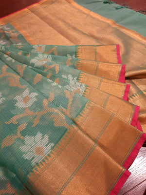 Light green kota saree with golden jaal and white flowers all over and golden zari weaving