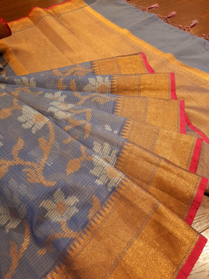 Light ink blue kota saree with golden jaal with white flowers all over and golden zari weaving
