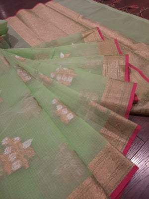 Light green kota saree with golden zari weaving and golden and white booties all over