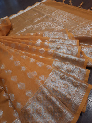 Dark yellow chanderi saree with silver zari weaving and silver booties all over