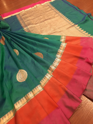Dark sea green katan silk saree with golden,orange and pink border and golden booties all over