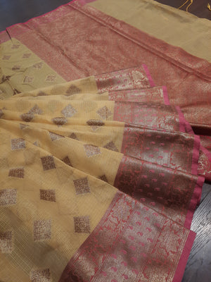 Yellow kota saree with golden zari weaving on pink border and golden booties all over