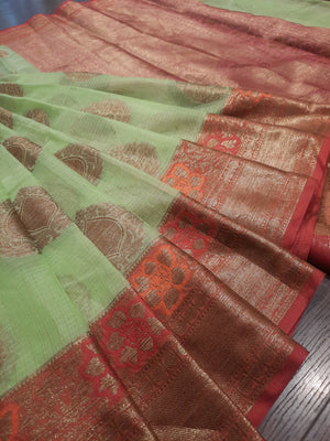 Green kota saree with golden zari weaving with multicolor flowers on red border and golden booties all over