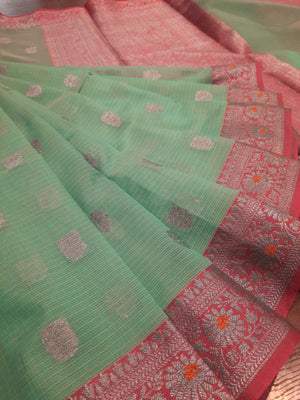 Sea green kota saree with silver zari weaving on pink border and silver booties all over