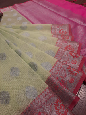 Light green kota saree with silver zari weaving on pink border and silver booties all over