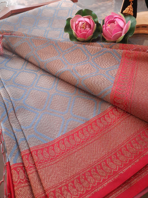 Grey soft silk saree with golden motifs all over and golden zari weaving on red border
