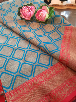 Blue soft silk saree with golden motifs all over and golden zari weaving on red border