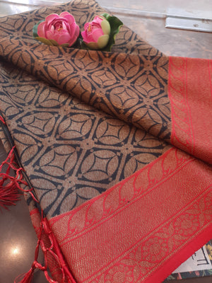 Black soft silk  saree with golden motifs all over and golden zari weaving on red border