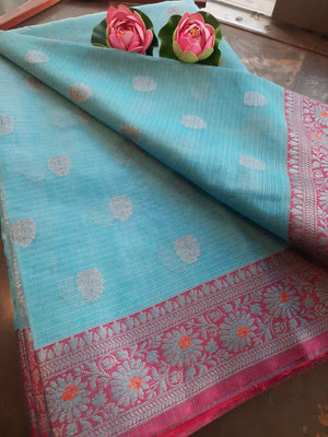 Light sky blue kota saree with silver zari weaving on pink border and silver booties all over