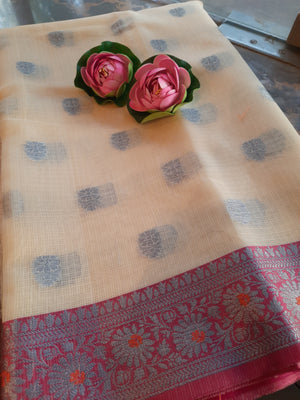 Cream kota saree with silver zari weaving on pink border and silver booties all over